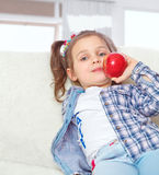 Little girl eating apples Royalty Free Stock Photography