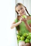 Little girl eating apples Royalty Free Stock Image