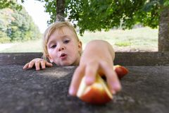 Little girl eating apples in tourist station in France. stock images