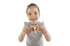 Little girl eating Asian cookies. Portrait of young girl who is eating Asian cookies with a chopsticks, isolated on white Stock Image