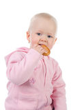 Little girl eating  bagel. Little girl holding a  bagel Royalty Free Stock Images