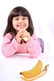 Little girl eating banana Royalty Free Stock Image