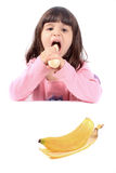 Little girl eating banana Royalty Free Stock Images