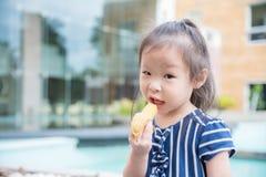 Little girl eating banana Stock Photography