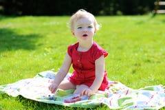 Little girl eating berries in the garden Stock Image