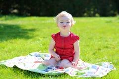 Little girl eating berries in the garden Royalty Free Stock Image
