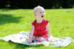 Little girl eating berries in the garden Royalty Free Stock Photos