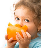 Little girl eating a big pepper Royalty Free Stock Photography