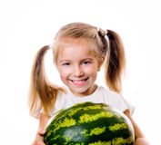 Little girl eating big piece of watermelon Royalty Free Stock Image
