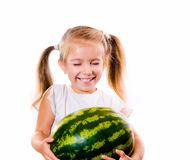 Little girl eating big piece of watermelon Royalty Free Stock Images