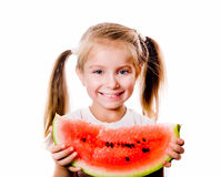 Little girl eating big piece of watermelon Royalty Free Stock Photo