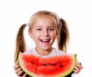 Little girl eating big piece of watermelon Stock Photos