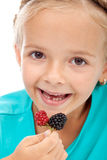 Little girl eating blackberries Royalty Free Stock Photos