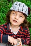 Little girl eating blueberries Stock Image