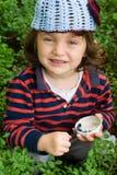 Little girl eating blueberries Royalty Free Stock Image
