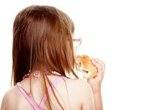 Little girl eating bread back view isolated Royalty Free Stock Photography