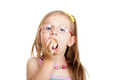 Little girl eating bread doing fun isolated Stock Photo