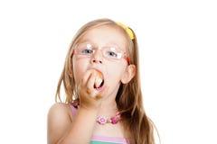 Little girl eating bread doing fun isolated Stock Photo