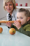 Little girl eating bread Royalty Free Stock Images
