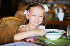 Little girl eating breakfast Stock Photo