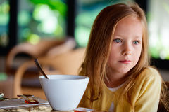 Little girl eating breakfast Stock Photography