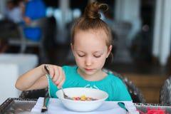 Little girl eating breakfast Royalty Free Stock Images