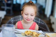 Little girl eating breakfast Stock Photography