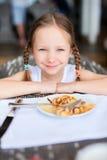 Little girl eating breakfast Stock Image