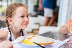 Little girl eating breakfast Royalty Free Stock Photo