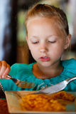Little girl eating breakfast Stock Photos