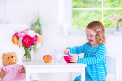Little girl eating breakfast Royalty Free Stock Images