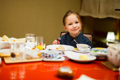 Little girl eating breakfast in Japan Royalty Free Stock Photography