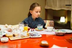 Little girl eating breakfast in Japan Royalty Free Stock Photos