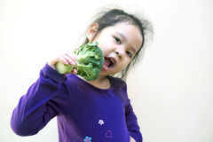 Little girl eating broccoli - healthy food Stock Image