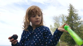 Little Girl Eating a Brownie and Playing with a Toy Sword stock video footage