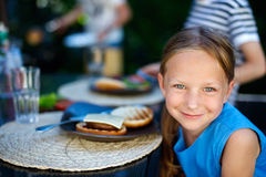 Little girl eating burger Royalty Free Stock Images