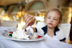 Little girl eating a cake Royalty Free Stock Photography