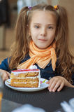 Little girl eating cake Royalty Free Stock Images
