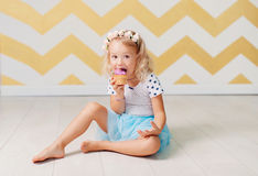 Little girl eating cake. The little girl has a beautiful cake royalty free stock images