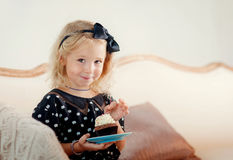 Little girl eating cake. The little girl has a beautiful cake royalty free stock photography