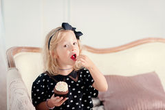 Little girl eating cake. The little girl has a beautiful cake stock image