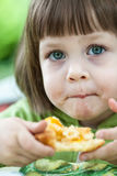 Little Girl eating cake with peach Royalty Free Stock Photos