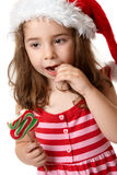 Little girl eating candy Royalty Free Stock Photos