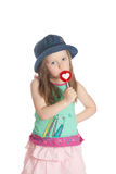 Little girl eating candy Stock Image
