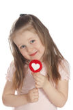 Little girl eating candy  lollipops Stock Photos