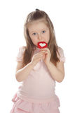 Little girl eating candy  lollipops Royalty Free Stock Images