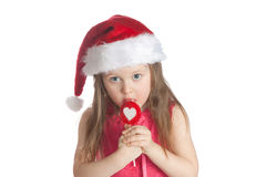Little girl eating candy  lollipops on white backg Stock Images