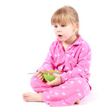 Little girl eating cereal Royalty Free Stock Photos