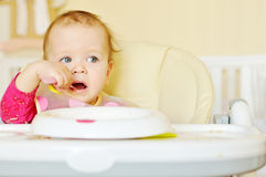 Little girl eating cereal Royalty Free Stock Images