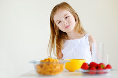 Little girl eating cereal with milk Royalty Free Stock Images